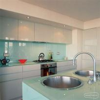 Glass cupboards, backsplash and countertops in kitchen